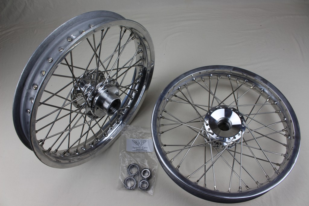 """+298  Front wheels,  Polished alloy billet hub, 18"""" Alloy rim, Stainless steel H.D. spokes, The lightest wheel option. Adaptable for all Triking models and direct replacement for the early type wheels with cast hubs."""