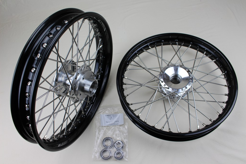 """+303   Front wheels, Polished alloy billet hub, Powder coated steel 18"""" rim, stainless steel H.D. spokes. Adaptable for all Triking models and direct replacement for early wheels with cast hubs."""