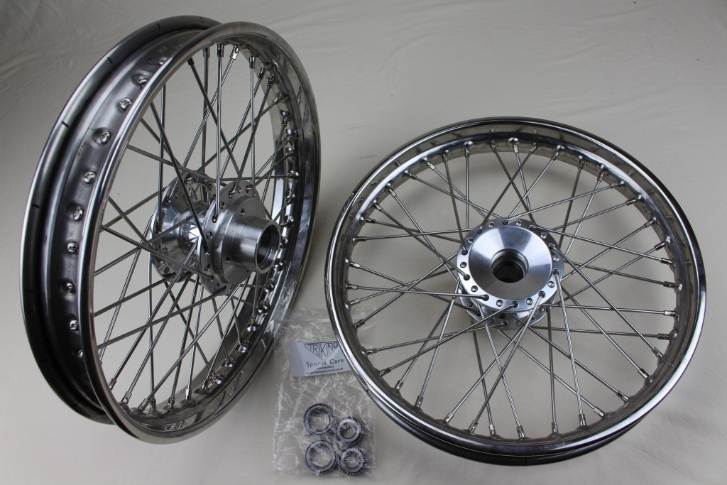 """+304    Front wheels, Polished alloy billet hub, 18"""" stainless steel rim, stainless steel H.D. spokes, requires minimal maintenance. Adaptable for all Triking models and direct replacement for earl wheels with cast hubs. , ,"""