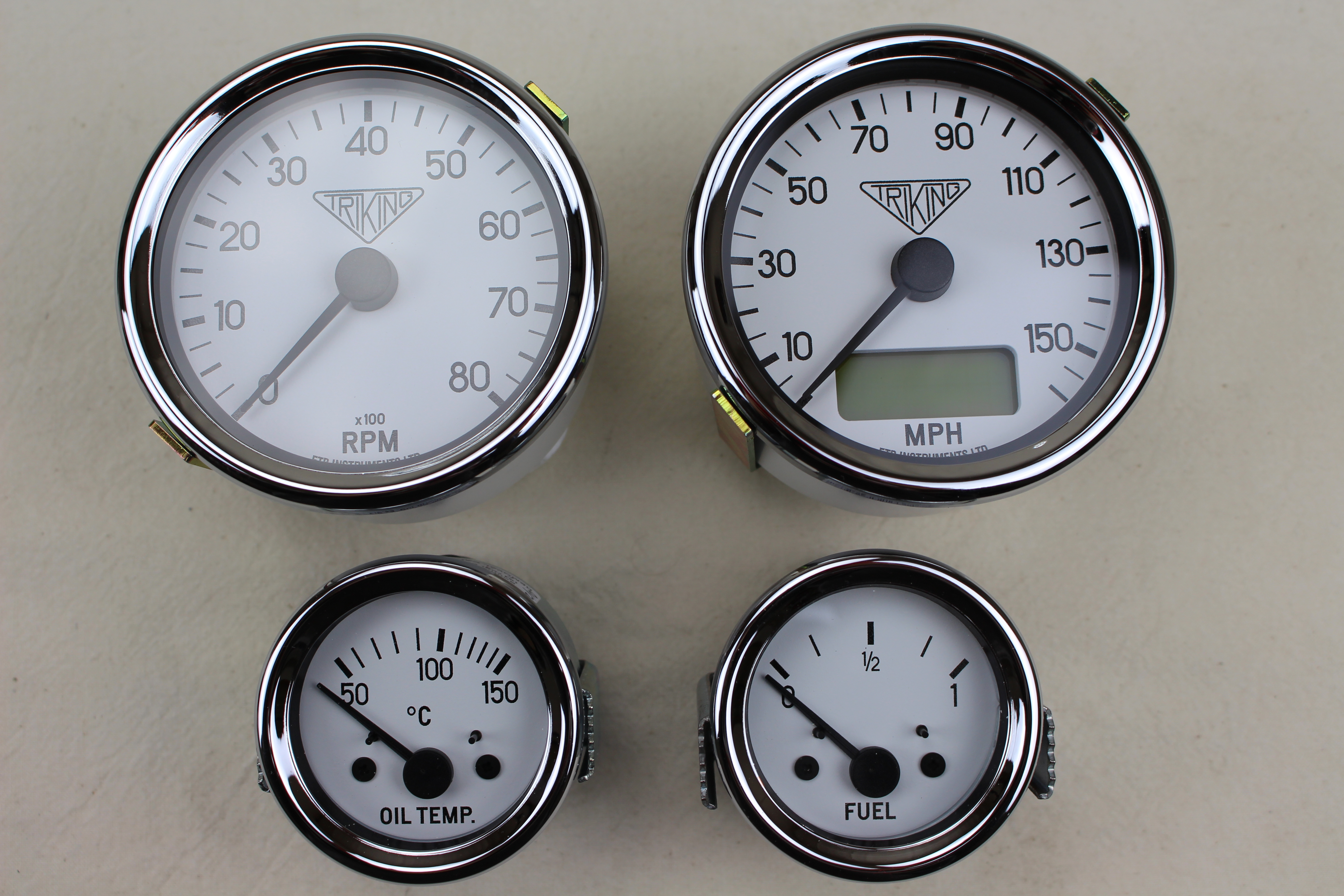 +842  Instruments _ gauges, Fully programmable electronic 80mm dia Speedo and Tacho with Triking logo, 52mm dia ancilliary gauges - extensive choice of bezel,colour and spec available.