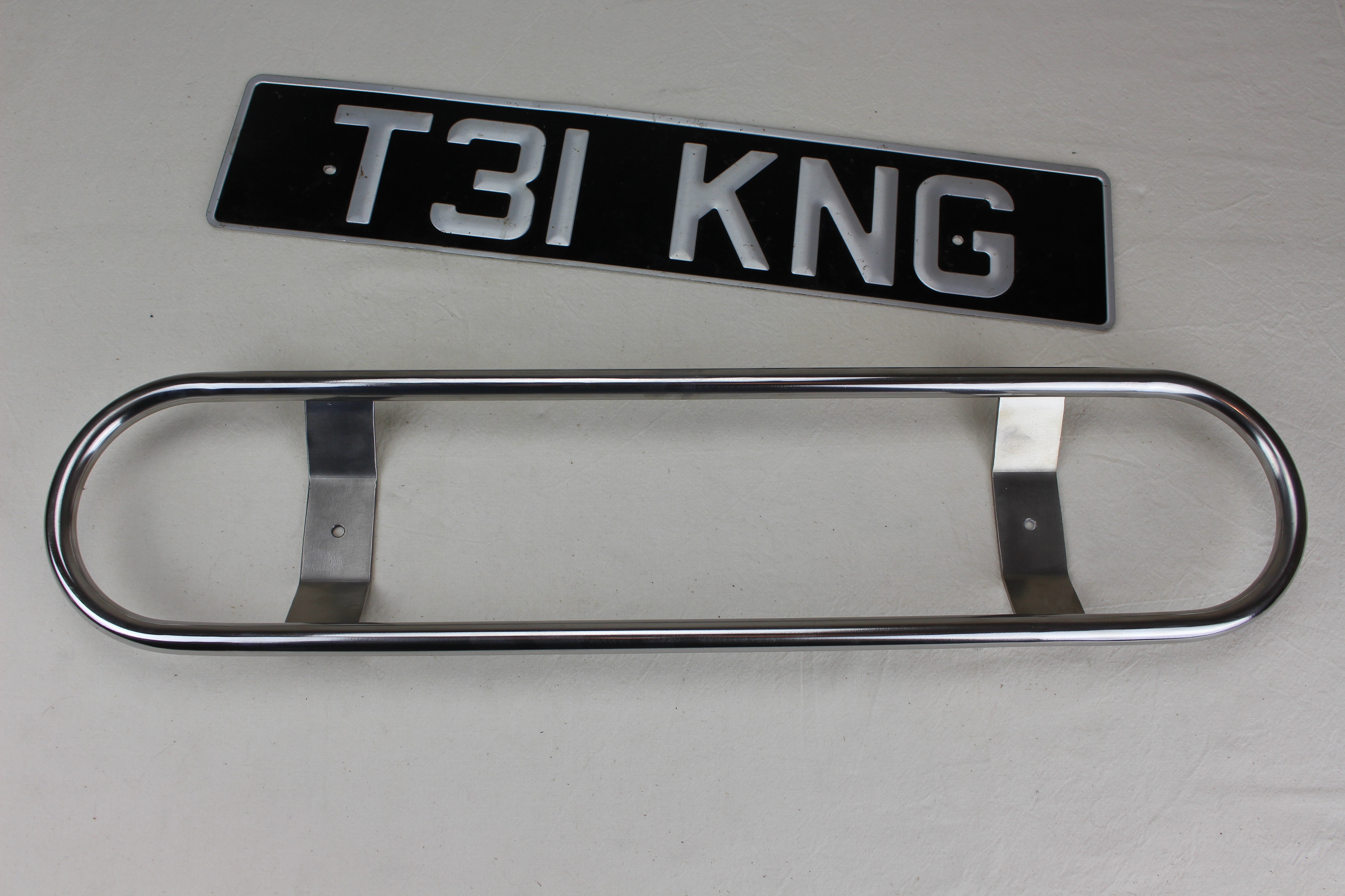 Badge bar, stainless steel, adaptable for all Triking models, accepts a std size number plate and or traditional _ classic type auto badges. Number plate shown for illustration purposes only.