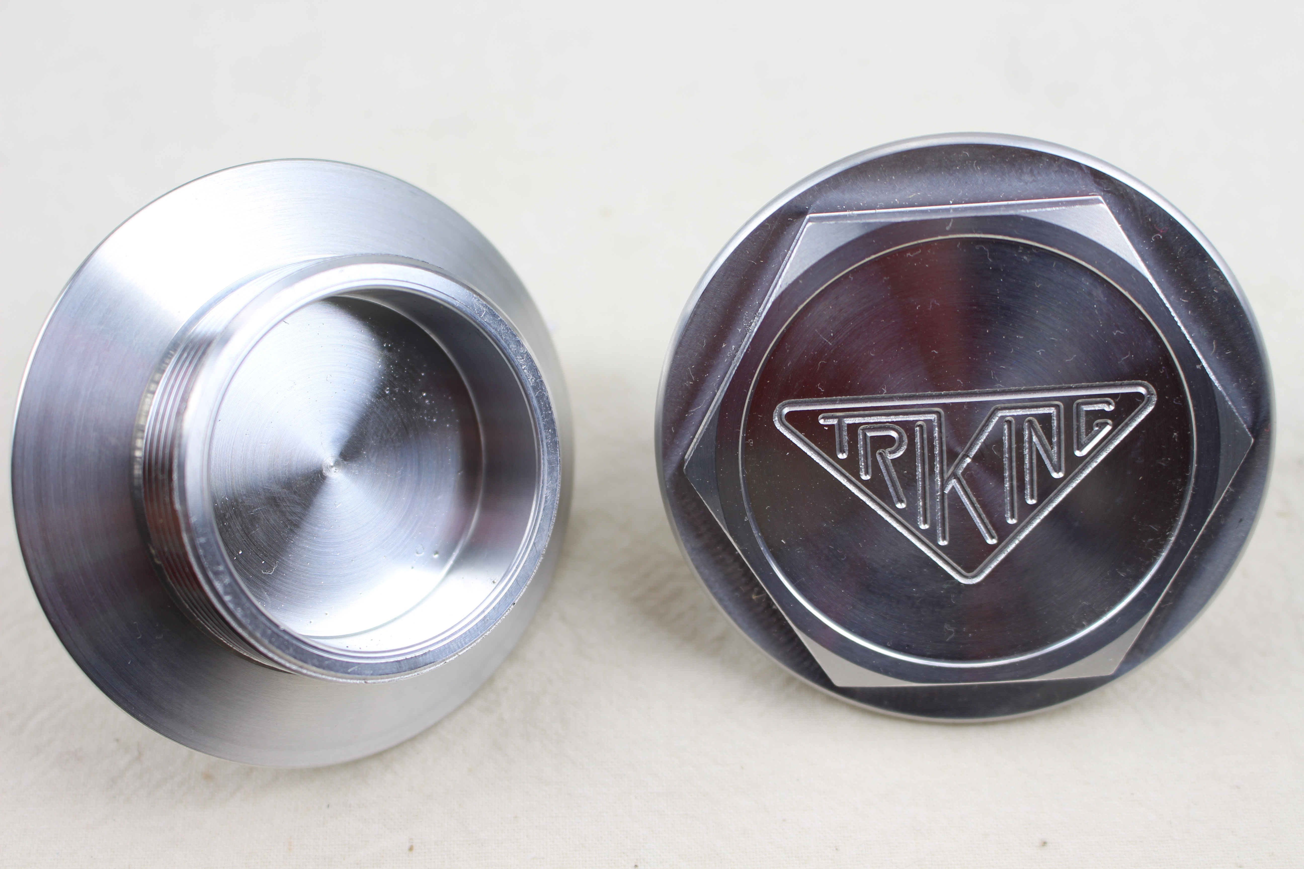 Billet alloy hub cap, machined with Triking logo suits all front wheels with threaded hubs, also available in brass, can be highly polished,