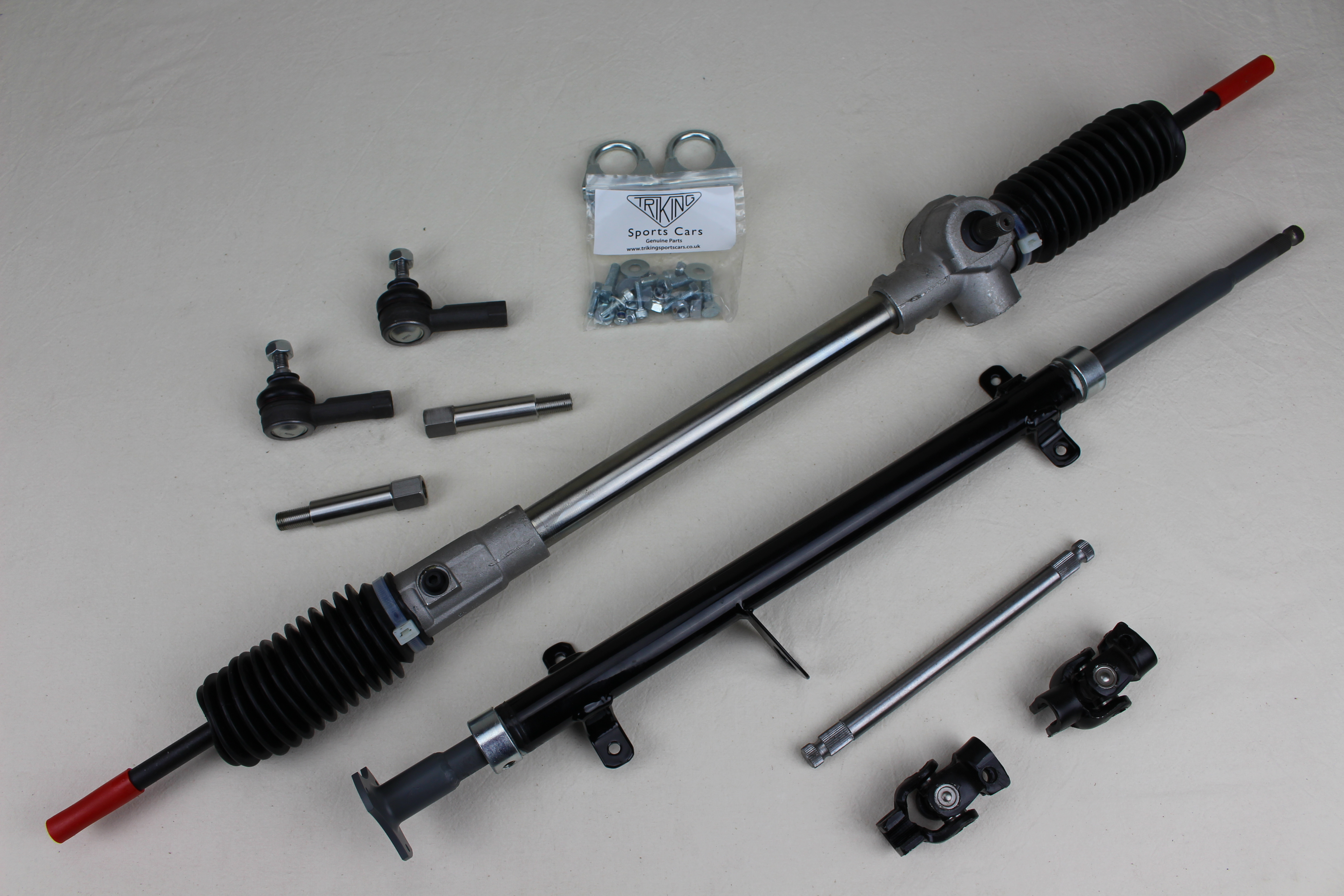 Complete steering assembly, Upper and lower column, couplings,  rack,all fittings, right or left hand drive, suits all Triking models, also available with quick release steering boss, Components also available individually.