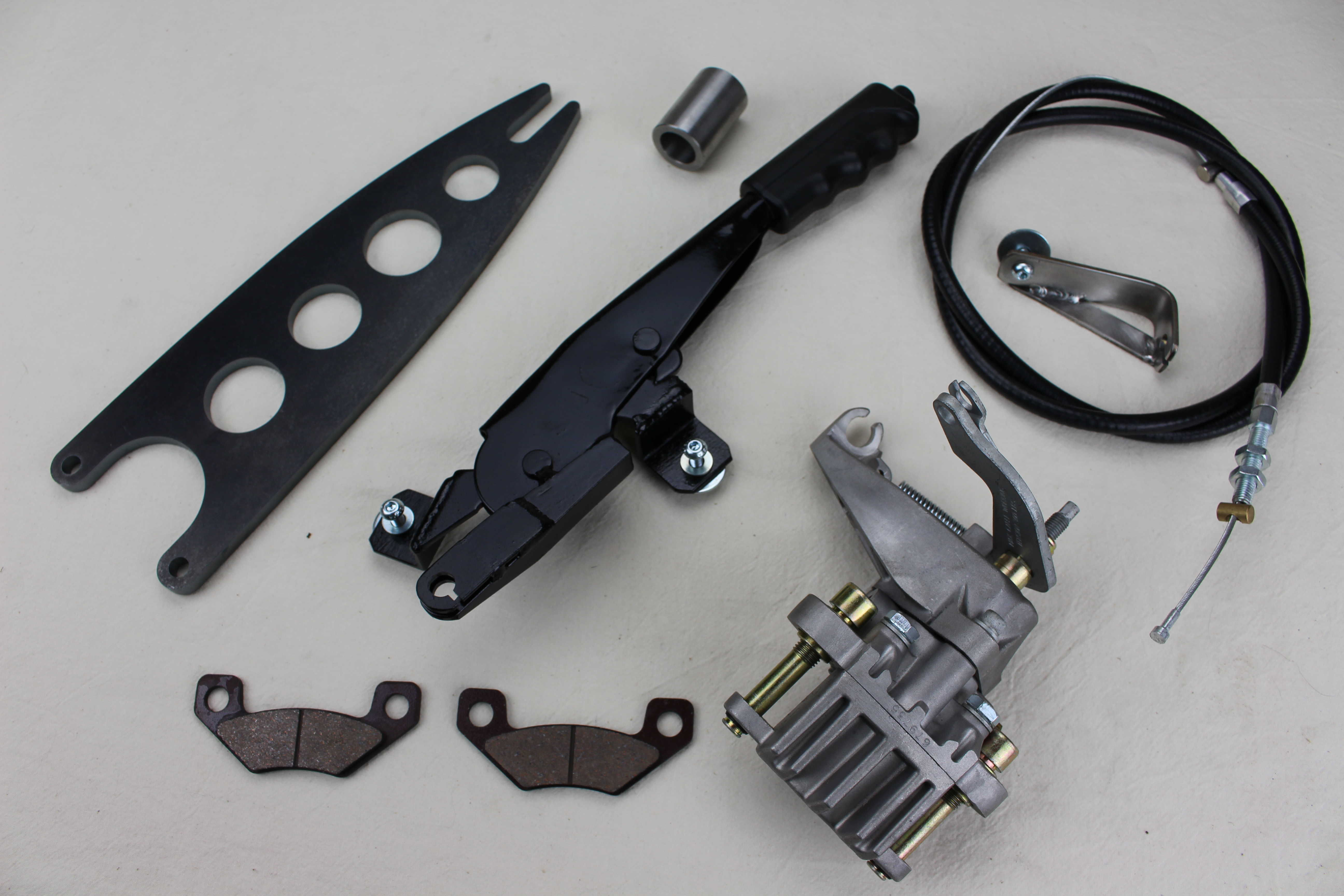 """Lightweight (rear) compact hydro-mechanical parking brake assemply, dual function caliper providing road wheel brake and parking brake function, Particularly usefull where space is restricted such as when fitting wider """"car"""" type rear wheel rims, Adap"""