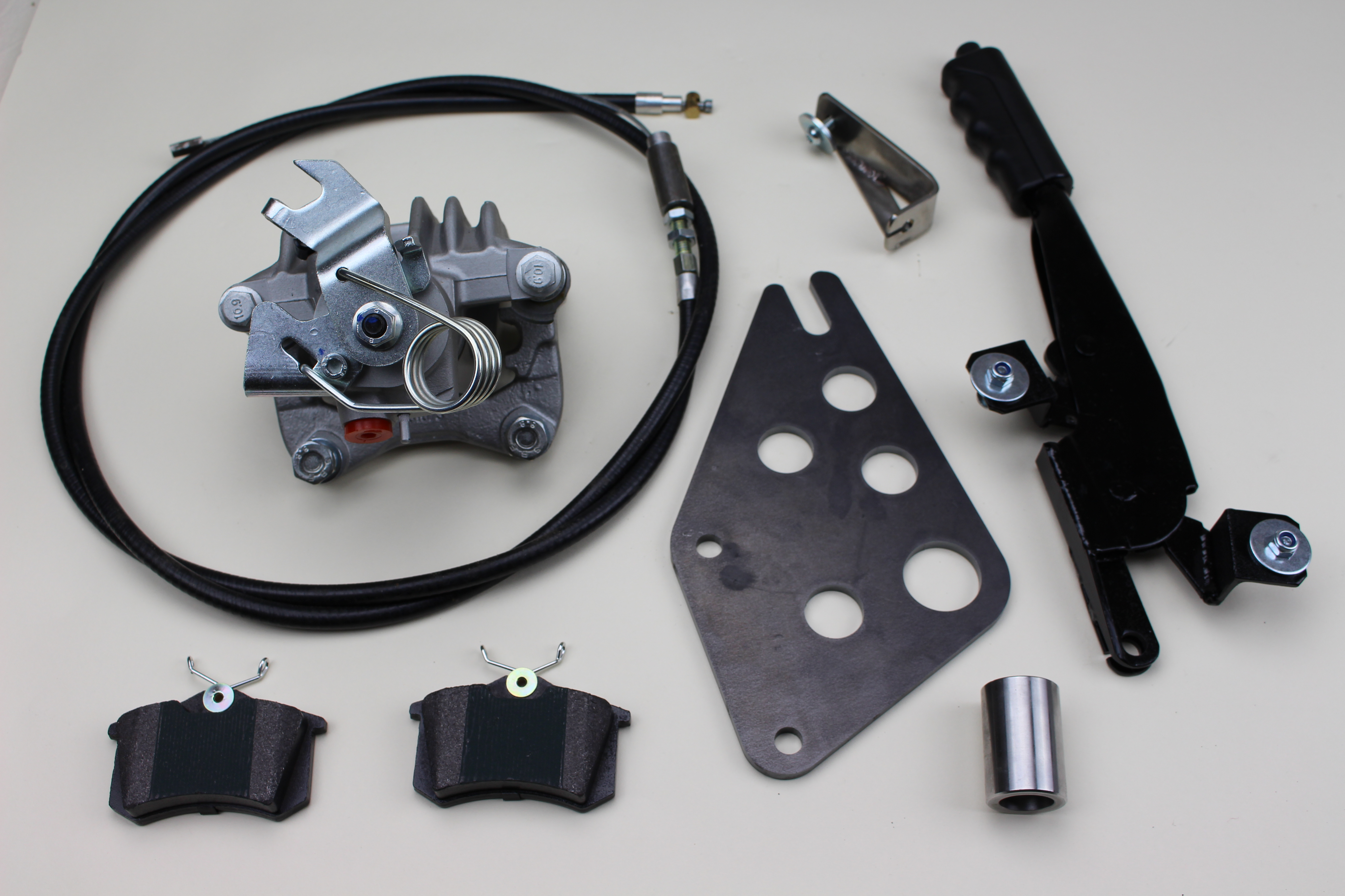Std (rear) parking brake assembly, hydro-mechanical caliper providing road wheel brake and parking brake, Supplied with universal mounting bracket for versatile fitment, Adaptable to all Triking models with Guzzi rear wheel and disc brake. Components