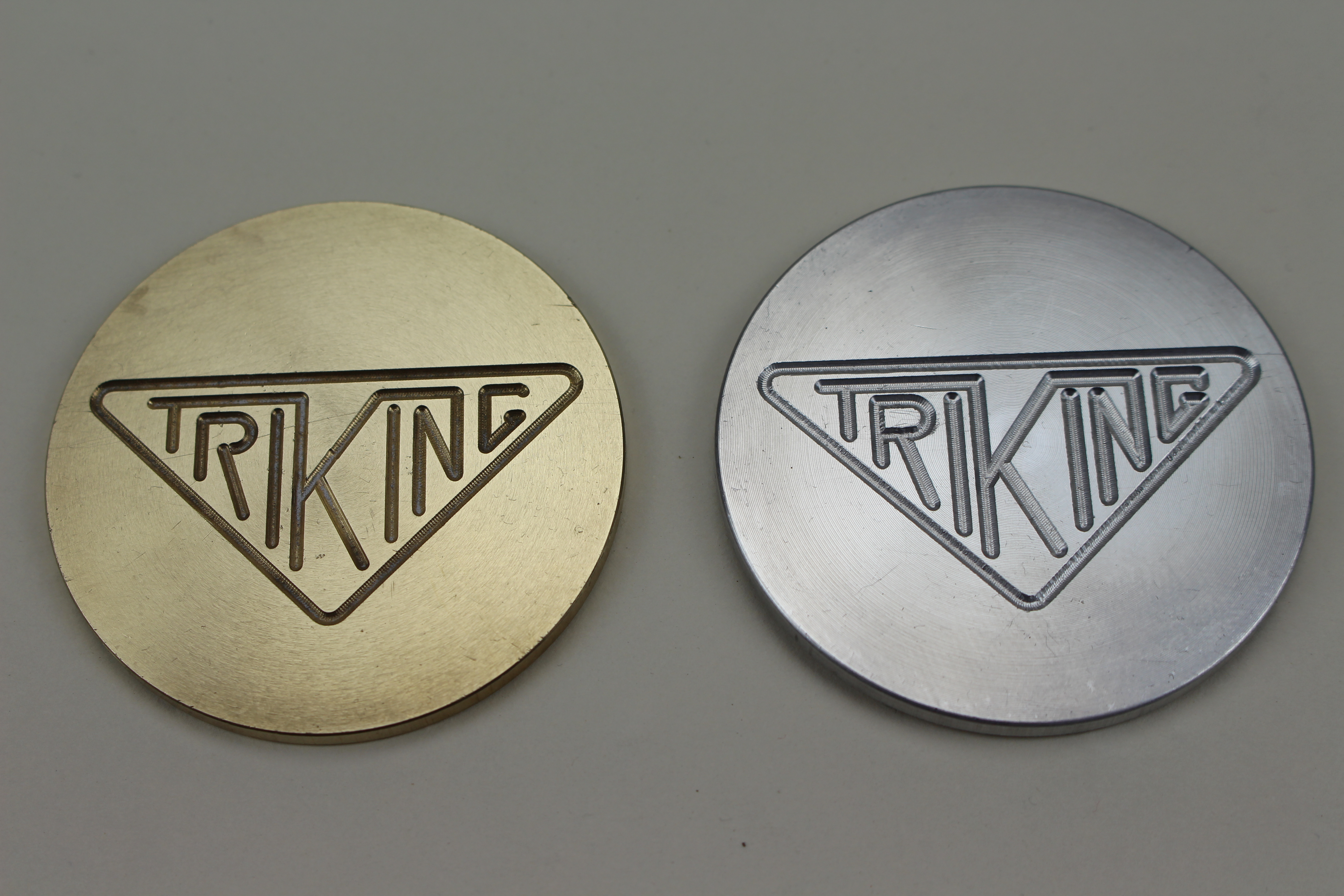 Triking badge, machined with triking logo, 50mm diameter, 3mm thick, available in Brass or Aluminium.